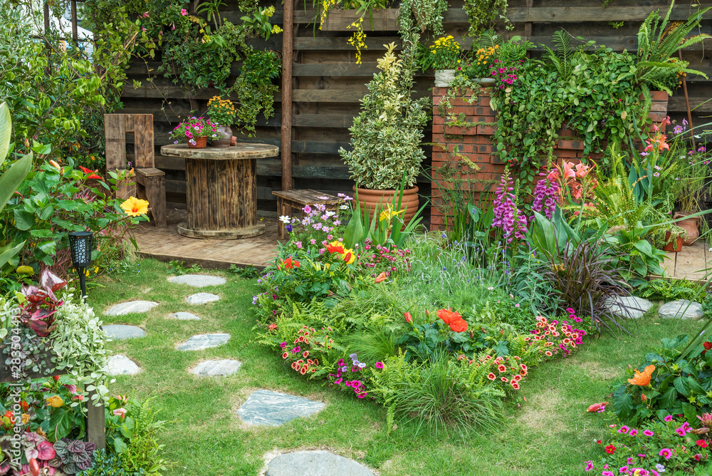 Fototapeta Landscaped backyard flower garden of residential house