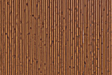 Background Of The Boards Facing The Wall. The Texture Of The Wooden Surface Of The Boards. Smooth Dark Brown Planks With Knots.