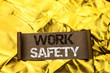 Leinwanddruck Bild - Handwriting text writing Work Safety. Concept meaning Caution Security Regulations Protection Assurance Safeness written Cardboard Piece the Golden textured background.