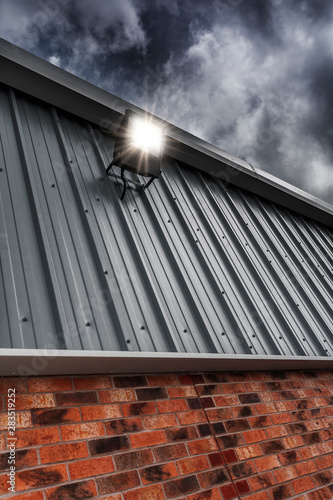 Obraz Security Light Mounted On A Factory Wall - fototapety do salonu