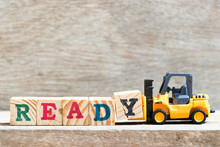 Toy Forklift Hold Letter Block Y To Complete Word Ready On Wood Background