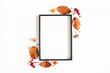 canvas print picture Autumn composition. Photo frame, flowers, leaves on white background. Autumn, fall, thanksgiving day concept. Flat lay, top view, copy space