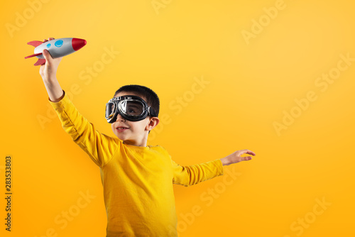 obraz lub plakat Child plays with a rocket. Concept of imagination.