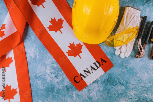 Canada happy labor day greeting card and yellow helmet