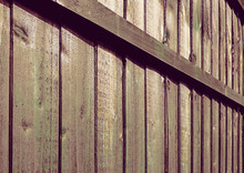 A Wooden Fence With Vertical P...