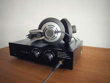 Black DAC Headphone Amplifier With Connected Headphones
