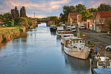 Saint-Gilles, Gard, Occitanie, France: Waterway With Boats In The Town At The Edge Of The Camargue