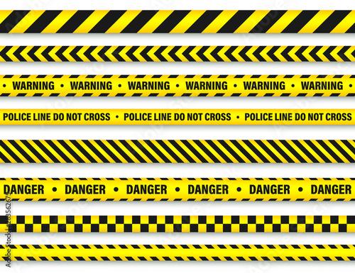 Fotografía  Yellow And Black Barricade Construction Tape