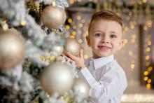 Little Boy Decorates A Christm...