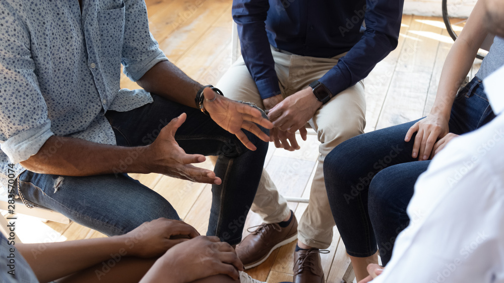 Fototapeta African man counselor speak at group counseling therapy session