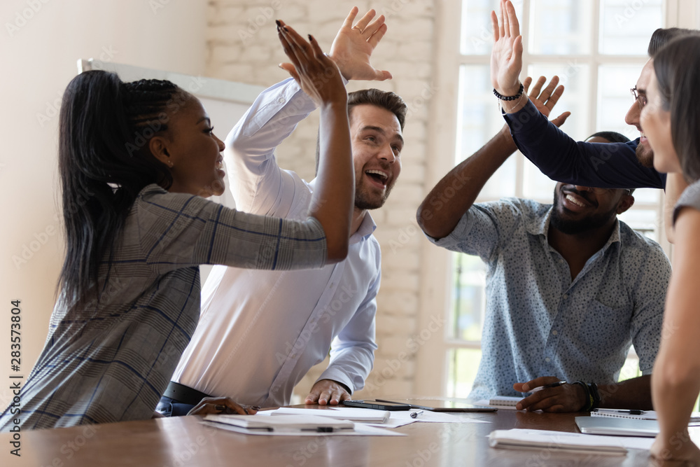 Fototapety, obrazy: Multiracial euphoric business team people give high five in office