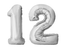Number 12 Twelve Made Of Silver Inflatable Balloons Isolated On White Background. Silver Chrome Helium Balloons Forming 12 Twelve Number
