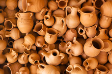 Clay Souvenir Pots Lie Together. Handmade For Sale. The View From The Top