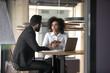 Leinwandbild Motiv African American businesswoman consulting client in boardroom