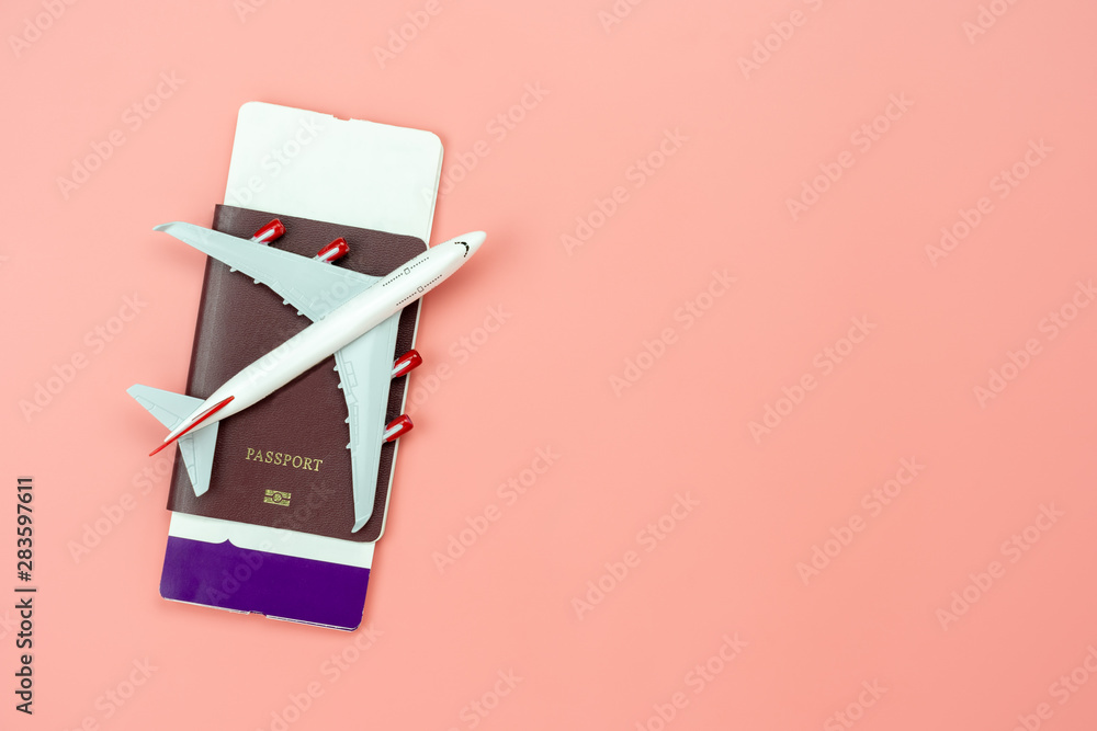 Fototapety, obrazy: Table top view accessory of accessory travel in holiday background concept.Flat lay of airplane with passport and boarding pass ticket on modern rustic pink paper at home studio office desk.copy space