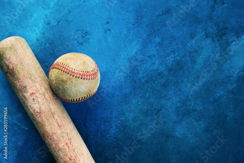 Old baseball bat with ball on blue texture background for sport graphic Canvas Print