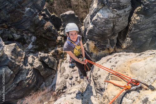 Girl rock climber abseiling from sandstone towers, Tisa sandstone rocks, Usti na Canvas Print
