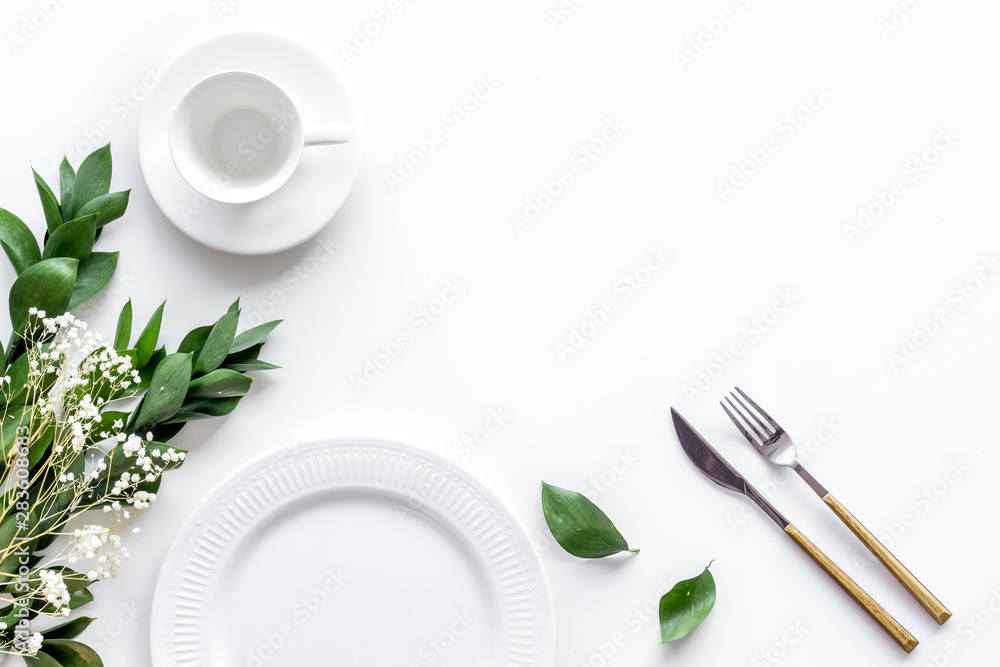 Fototapety, obrazy: Table setting with plates, flatware and flower on white background top view copy space