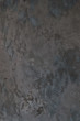 Art stylized decorative dark gray cement plaster wall as background texture