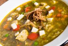 Peruvian Cilantro Chicken Soup Or Aguadito De Pollo With Yukon Gold Potatoes Corn On The Cob And Lime Slice