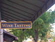 Wine Tasting Sign Hanging In Front Of Downtown Shops
