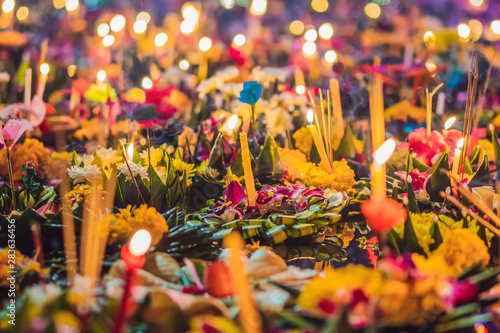 Poster Kaki Loy Krathong festival, People buy flowers and candle to light and float on water to celebrate the Loy Krathong festival in Thailand
