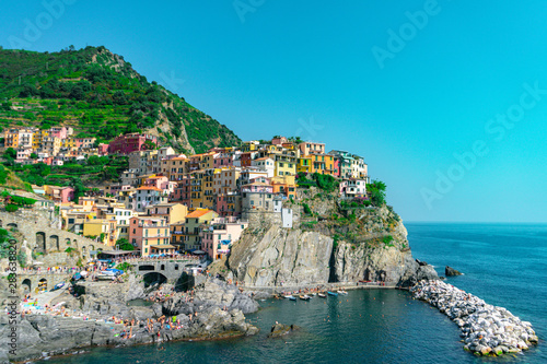 Fototapety, obrazy: Amazing view of Manarola village in Cinque Terre, Italy. Sunny day and blue sky of an afternoon in the European summer. Unesco World Heritage Site