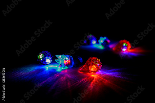 Multi-colored red, green, and blue glowing party rings, lights, and bracelets