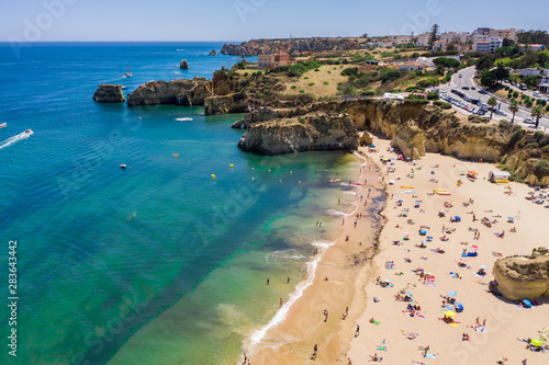 Fotografia  Tourists relaxing on Praia da Batata beach, Lagos, Algarve, Portugal, Europe, ae