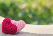 Red And Pink Hearts On Wooden Swing With Beautiful Blurred Background