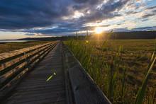 Long Wooden Boardwalk Strechin...