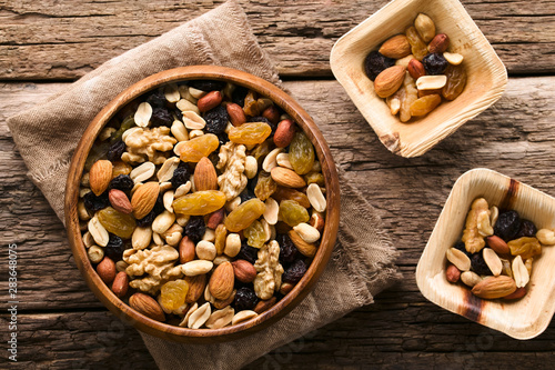 Fotomural Healthy trail mix snack made of nuts (walnut, almond, peanut) and dried fruits (