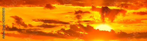 Stickers pour portes Orange eclat sunset sky with clouds and setting sun panorama landscape background panoramic wide view of natural color of sunrise dawn heaven with dramatic cloudscape design wallpaper high resolution photo