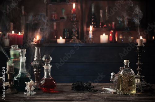 Canvas Print magic potions in bottles on wooden background