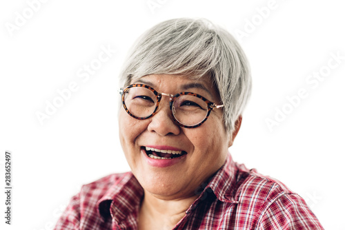 Photographie  Portrait of happy senior adult elderly asia women smiling and looking at camera on white background
