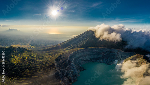 Foto auf Leinwand Blaue Nacht Aerial view of beautiful Ijen volcano with acid lake and sulfur gas going from crater, Indonesia