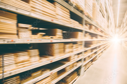 Photo  blur speed moving of warehouse storage inventory for fast shipping background