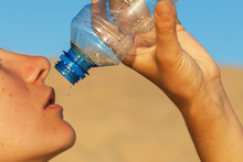 Man Finishes The Last Water. Concept On The Topic Of Thirst, Close-up