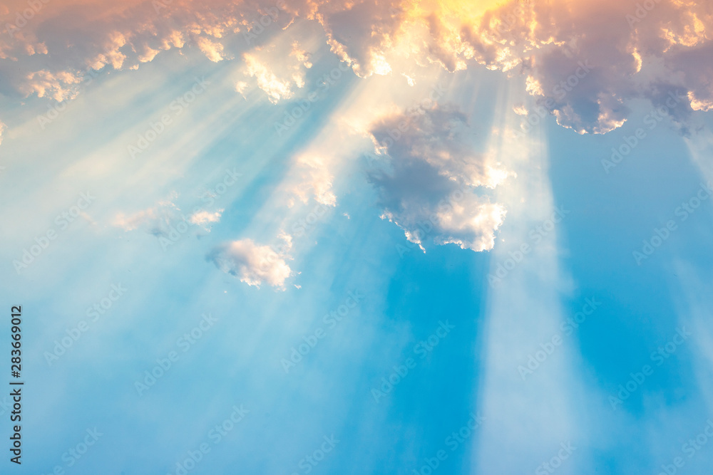 Fototapety, obrazy: Besutiful ray of sunlight breaking through clouds at sunset.