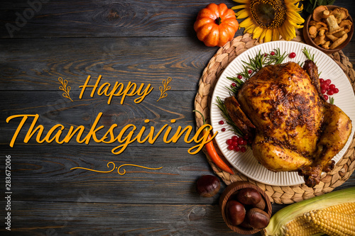 Happy Thanksgiving holiday background. Roasted whole chicken or turkey with autumn vegetables for thanksgiving dinner on wooden background - 283672006