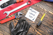 Set of tools, card with text LABOR DAY and USA flag on wooden background