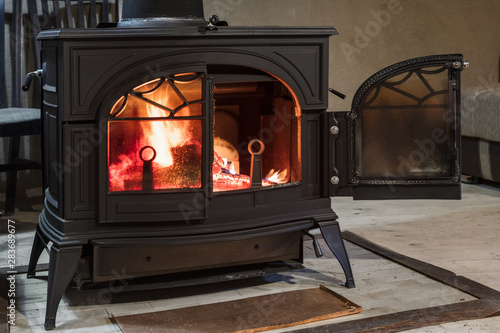 Fotografija burning wood in the stove in country house