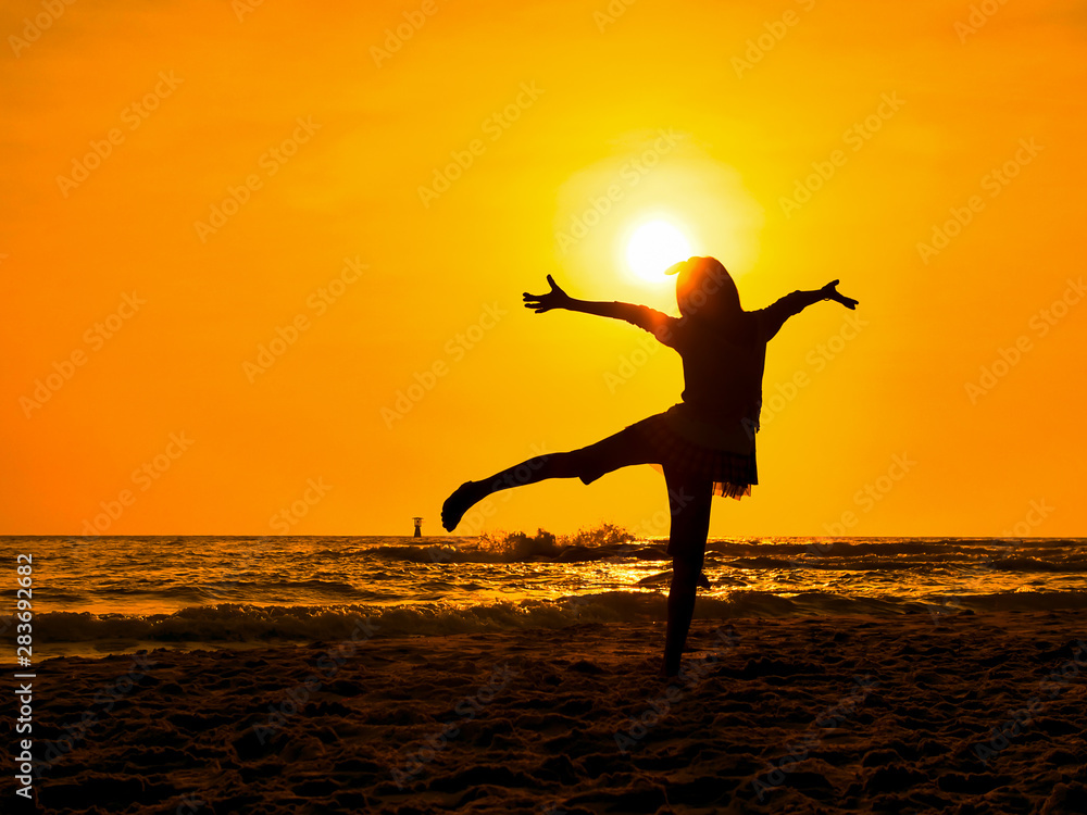 Fototapety, obrazy: Silhouette girl dancing ballet on the beach in sun rise.