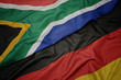 canvas print picture - waving colorful flag of germany and national flag of south africa.