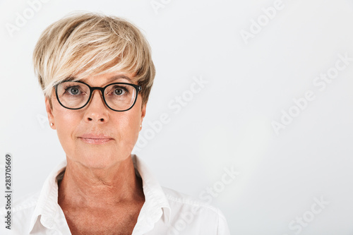 Canvastavla  Portrait closeup of caucasian middle-aged woman wearing eyeglasses looking at ca