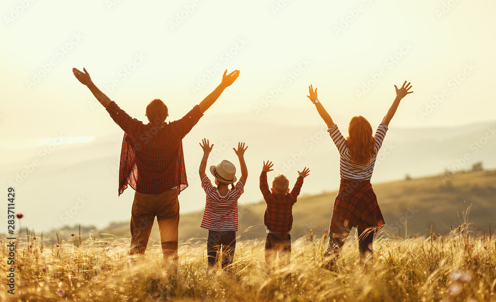 Fototapeta Happy family: mother, father, children son and daughter on sunset