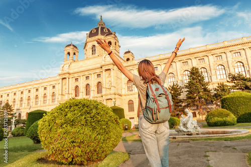 Happy Young asian woman tourist or student near museum of Art History in Vienna Wallpaper Mural