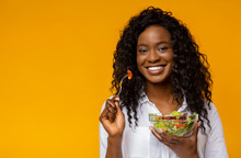 Happy African American Woman Eating Vegetable Salad