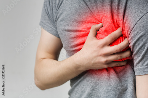 Fototapeta  Caucasian man having heart ache, holding hand on chest