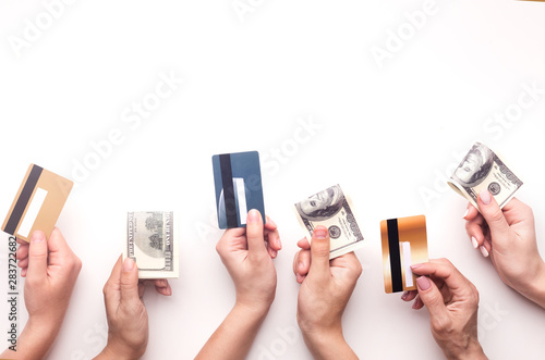 People with money in hands ready to pay for something